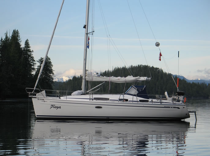Freya moored in Joe Cove, Eden Island, The Broughtons on one of her charters by club members.
